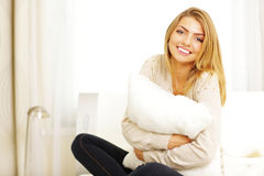 beautiful woman hugging pillow Royalty Free Stock Photography