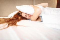 Beautiful woman hugs pillow, waking up stock images