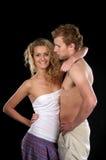 Beautiful woman hugs semi-dressed Royalty Free Stock Photography