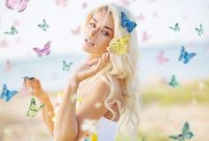 Beautiful woman among hundreds butterflies. Beautiful woman among hundreds colorful butterflies Royalty Free Stock Image