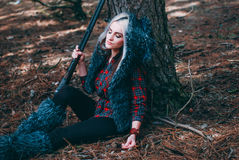 Beautiful woman hunter in forest with gun Stock Photography