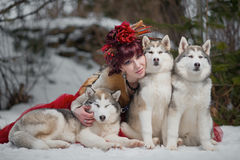 Beautiful woman with a husky dogs Royalty Free Stock Photos