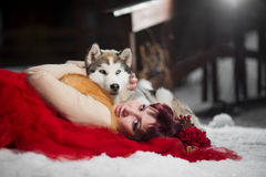 Beautiful woman with a husky dogs Royalty Free Stock Photo