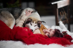 Beautiful woman with a husky dogs Stock Photography