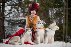 Beautiful woman with a husky dogs Royalty Free Stock Images