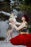 Beautiful woman with a husky dogs Royalty Free Stock Photography