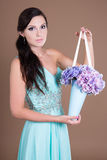 Beautiful woman with hydrangea flowers bouquet Stock Image
