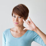Beautiful woman with I love you hand sign gesture Royalty Free Stock Image