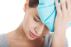 Beautiful woman with ice bag, having headache. Royalty Free Stock Images