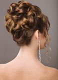Beautiful  woman in image of the bride. Beauty hair. Hairstyle back view Stock Image