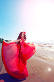 Beautiful Woman In A Bright Red Dress Royalty Free Stock Images