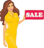 Beautiful Woman In A Yellow Dress Holds A Sale Sign Stock Photo