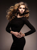 Beautiful Woman In Black Bodycon Dress With Long Curly Hair Royalty Free Stock Photography