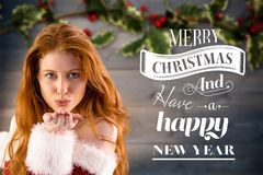 Free Beautiful Woman In Santa Costume Blowing A Kiss With Christmas Greetings Stock Image - 80552081