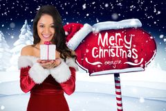 Free Beautiful Woman In Santa Costume Holding Christmas Gift Stock Image - 80559061