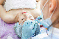 Beautiful Woman In Spa Salon Receiving Epilation Or Correction E Stock Photography
