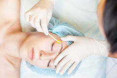 Beautiful Woman In Spa Salon Receiving Epilation Or Correction Eyebrow Stock Images