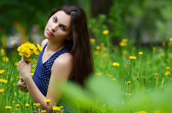 Beautiful Woman In The Field With Dandelions Royalty Free Stock Photo