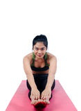Beautiful woman indoor exercising using pink yoga mat Stock Photography