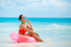 Beautiful woman with inflatable life buoy Stock Photography
