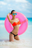 Beautiful woman with inflatable life buoy Stock Photo
