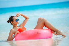 Beautiful woman with inflatable life buoy Stock Photos