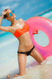 Beautiful woman with inflatable life buoy Stock Images