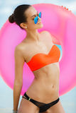 Beautiful woman with inflatable life buoy Royalty Free Stock Image