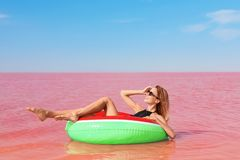 Beautiful woman on inflatable rin royalty free stock photo