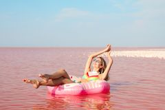 Beautiful woman on inflatable ring royalty free stock image