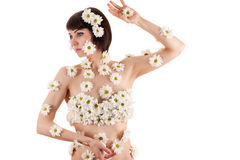 Beautiful woman in inflorescences of chrysanthemums on the body Royalty Free Stock Photo
