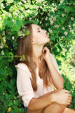 Beautiful woman inhale the aroma of white flowers Royalty Free Stock Images