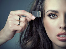 Sensual woman inserting card into her head Royalty Free Stock Photos