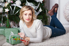 Beautiful woman in the interior with Christmas decorations. Stock Images