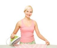Beautiful woman ironing clothes Stock Photos