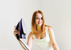 beautiful woman ironing clothes. Housework Royalty Free Stock Image