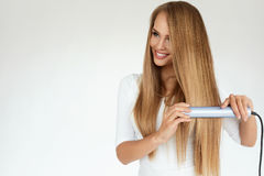 Beautiful Woman Ironing Long Straight Hair With Straightener Stock Images