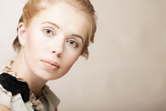 Beautiful woman isolated on beige Royalty Free Stock Images