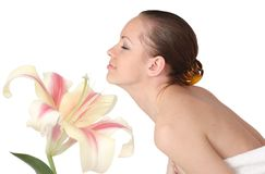 Beautiful woman isolated with flower. Beautiful woman isolated with big lily flower Royalty Free Stock Image