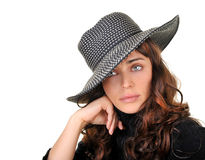 Beautiful woman isolated on white. Gorgeous fashion model wearing a hat isolated on white background with room for text Royalty Free Stock Photo