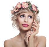 Beautiful woman isolated on white. Portrait of pretty model with makeup, blonde hair and flowers.  royalty free stock images