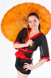Beautiful woman in japanese kimono. Young attractive woman in japanese kimono with umbrella at white background Royalty Free Stock Photos