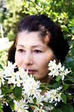 Beautiful woman with jasmine flowers Stock Images
