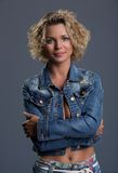 Beautiful woman in  jeans and jacket Royalty Free Stock Images
