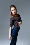 Beautiful woman in jeans Stock Image