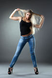 Beautiful woman in jeans show hairs Royalty Free Stock Images