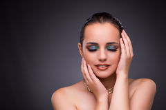The beautiful woman with jewellery in beauty concept Stock Image