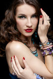 Beautiful woman in jewelry Royalty Free Stock Photos