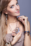 Beautiful woman in jewelry and  bijouterie Stock Photo