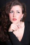 Beautiful woman in jewelry Head Shot. Beautiful brunette in jewelry Head Shot Stock Image